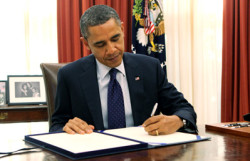 President Obama signing the Breast Cancer Patient Education Act